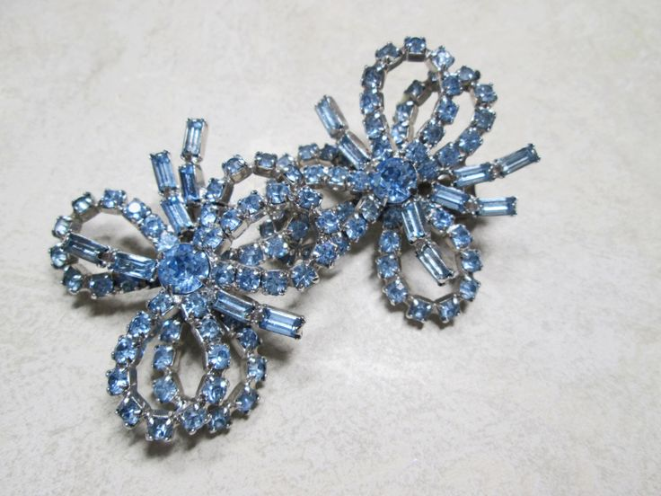 Kramer of New York Light Blue Rhinestone Bow Earrings,signed Clip on by FiorellaVintage on Etsy https://www.etsy.com/listing/236979510/kramer-of-new-york-light-blue-rhinestone