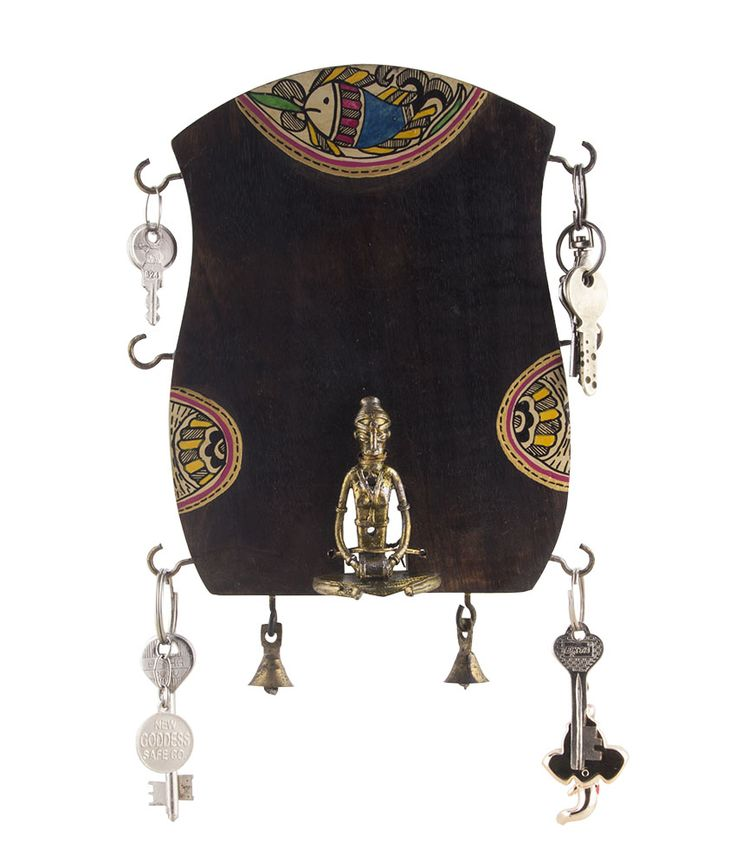 This unique key holder has been hand crafted from mango wood and the figurine is made of brass. The madhubani work done on the sides and the top adds on to the beauty of this holder.