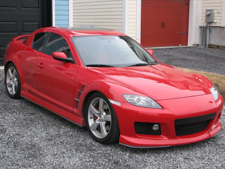 Red   Mazda RX 8 Is A Four Seat Sport Coupe With A Pair Of Rear Hinged Doors.The  RX 8 Is Powered By A 1.3 Liter Twin Rotor Wankel Engine.
