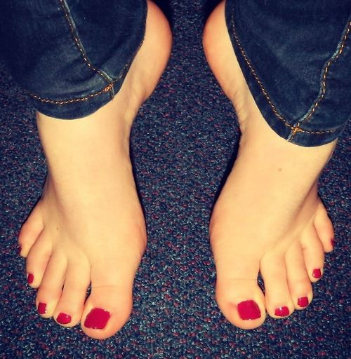Cute Feet With Red Toe Nail Polish