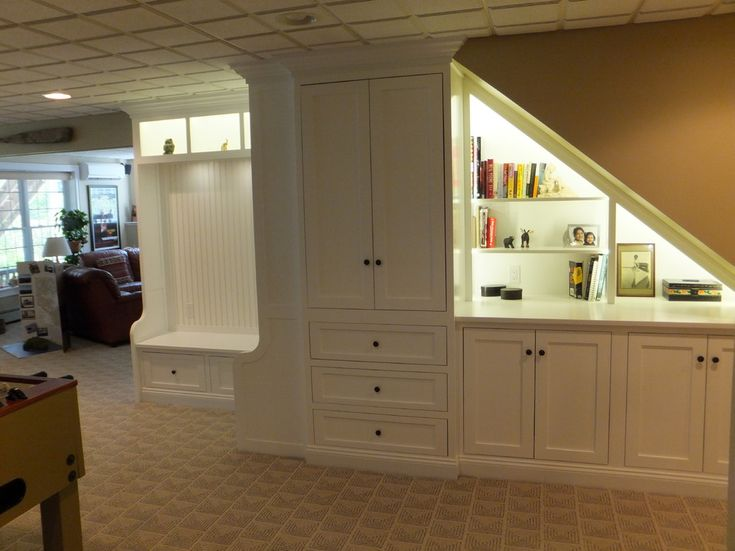 Gorgeous Under Stair Storage method Manchester NH Traditional Basement Decoration ideas with basement built-in cabinet basement