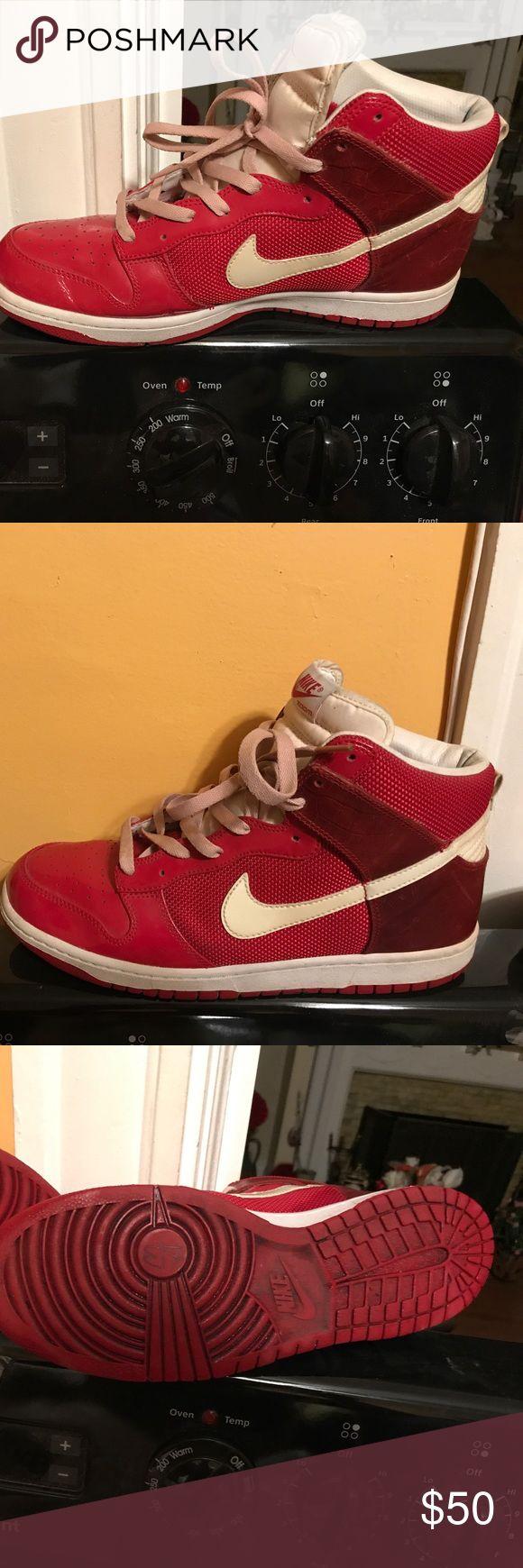 Men's Nike hi top sneaker Size 11 red men's hi top Nike sneaker. Worn once.  Red sneaker w/ white Nike symbol. Nike Shoes Athletic Shoes