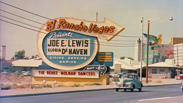 El Rancho Vegas Hotel and Casino vintage neon directional sign.  The Thunderbird Hotel can be seen in the background.  Las Vegas