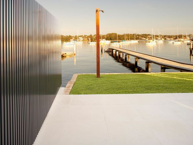 Eco Outdoor Dauville limestone with contemporary fence detail. BKA Architects   Embark Design   Ganellen Construction   Eco Outdoor   Limestone   livelifeoutdoors   Outdoor Design   Natural stone flooring   Garden design   Outdoor paving   Outdoor design inspiration   Outdoor style   Contemporary pool ideas   Luxury homes   Paving ideas   Garden ideas   Pool design ideas