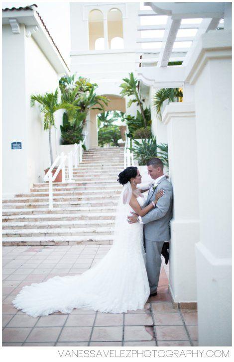 The wedding couple shares a loving moment at Las Casitas Village. Destination Wedding | El Conquistador Resort & Las Casitas Village | Puerto Rico | ElConResort.com Vanessa Velez Photography