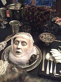 old silverware and serving pieces make for a great table. #halloweendecor