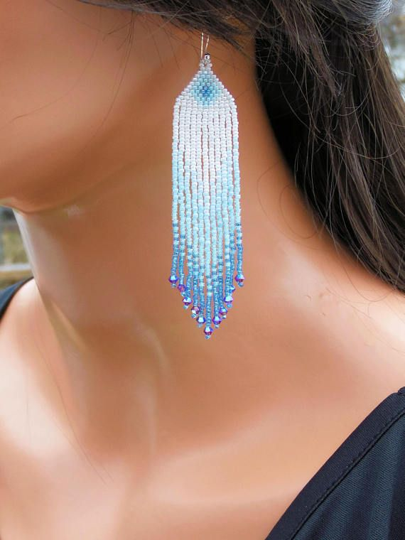 I used brick stitch (also known as cheyenne stitch) to make these earrings; they are my own pattern. * Ombre Earrings in Shades of Sapphire Blue and White * 3mm Swarovski Crystals on Bottom of Fringe * Super Lightweight * 3 3/4 Long - Including the Sterling Silver Ear-Wires *