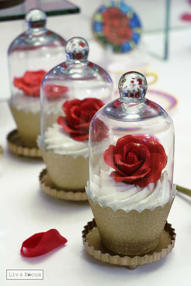 Red rose cupcakes at a Beauty and the Beast Quinceañera birthday party! See more party ideas at CatchMyParty.com!
