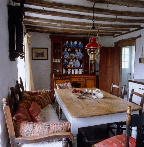 Such a warm and cozy British dining room, antiques, home is probably hundreds of years old.