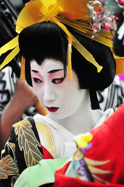 """OIRAN (花魁) were high-class courtesan or prostitute.The word """"Oiran"""" consists of two kanji 花 meaning """"flower"""", and 魁 meaning """"leader"""" or """"first."""" Oiran tied their obi's at the front while Geisha at the back. Oiran practiced the arts of dance, music, poetry and calligraphy, and an educated wit was essential to sophisticated conversation. Their speech preserved the formal court standards.The rise of the GEISHA ended the era of the OIRAN. The last recorded oiran was in 1761."""