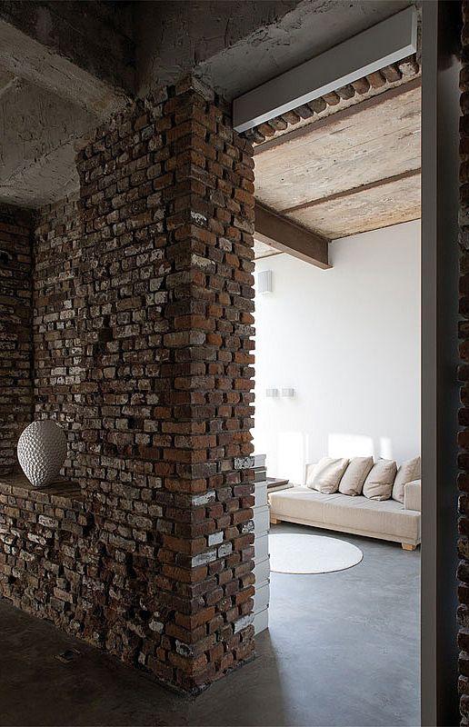 Masculine interior design home with rustic brick wall DUSSELDORF / Atelier d'Architecture Bruno Erpicum & Partners