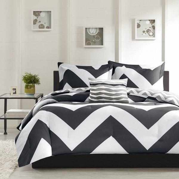 La housse de couette Libra ajoute un pop dramatique à votre chambre à coucher avec un imprimé chevron gras noir et blanc qui crée un look dynamique amusant de toute chambre à coucher . A plus petite échelle de gris et blanc imprimé chevron couvre l'inverse.