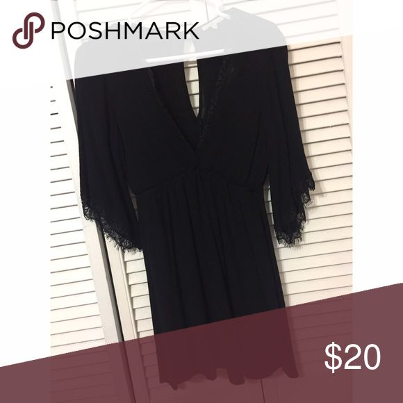 Black dress Above knee length black dress with lace at the end of arm sleeve. Arm sleeve is medium length. Charlotte Russe Dresses