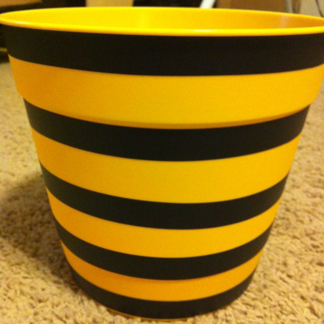 Bee theme pot for plants. Yellow pot from Wal-Mart (about $3). Use electrical tape around the pot - instant bumble bee pot!