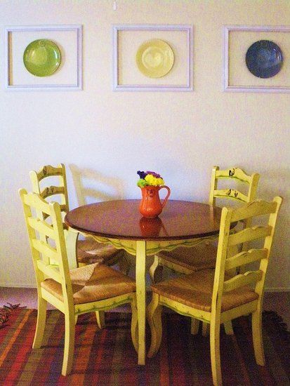DIY Dining Room Hanging Plates on Wall Decor  would love to do this with Fiesta plates!
