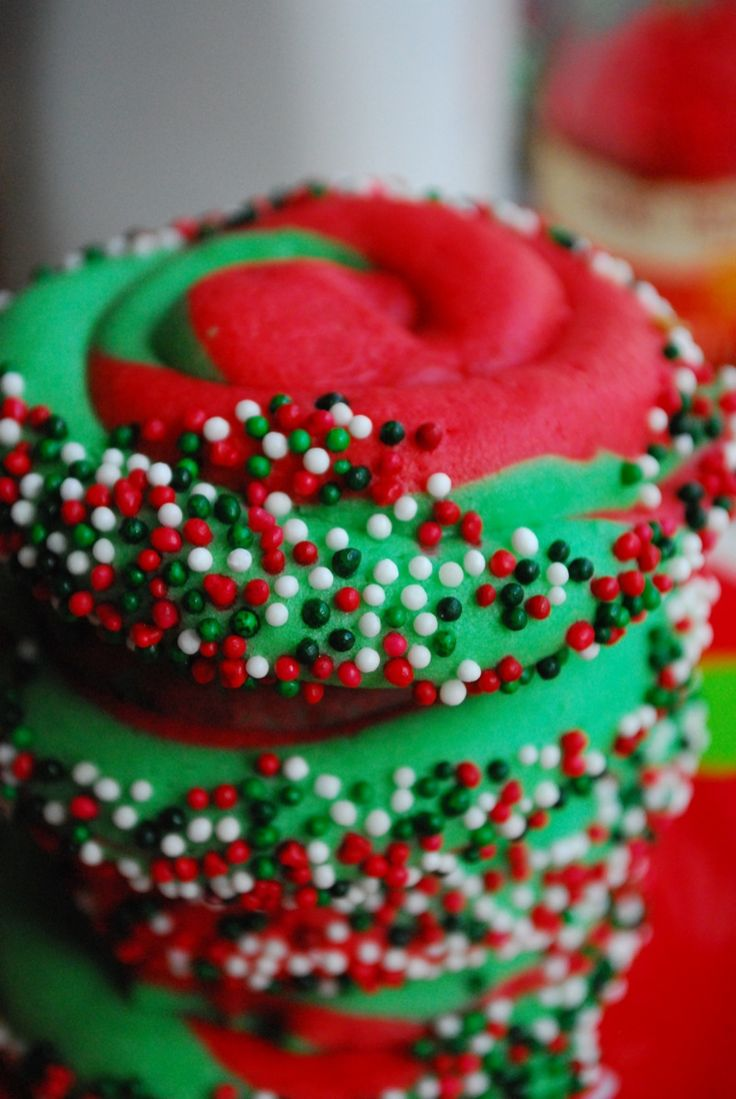 """Christmas Swirl Sugar Cookies. Could make this a whole lot easier by buying premade dough and coloring it. Roll one """"snake"""" of each color, then roll them around each other into a cookie."""