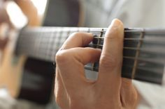 Erin--check this out.wikiHow to Rapidly Learn to Play the Acoustic Guitar Yourself -- via wikiHow.com