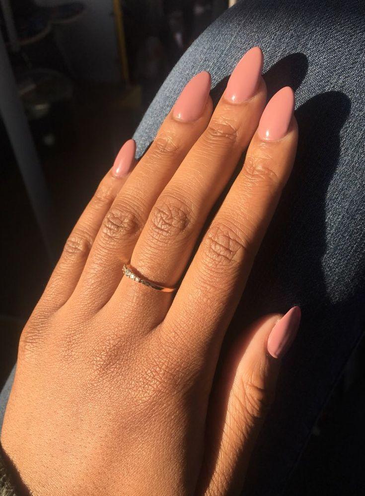 Pink almond / stilleto shaped short nails