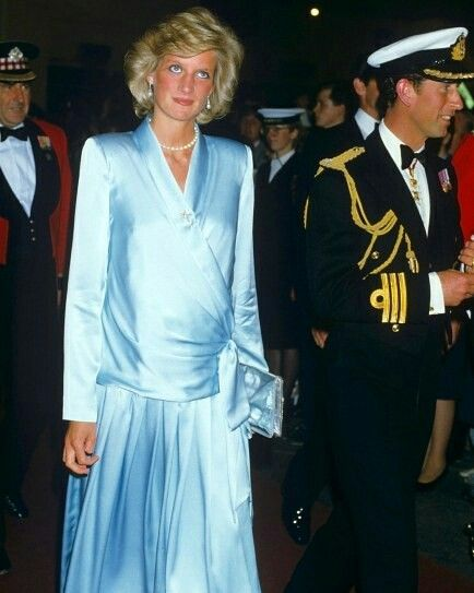 26 July 1984: Prince Charles and his wife Princess Diana, seven months pregnant with Prince Harry, attend The Royal Tournament held by the British Armed Forces at Earls Court Exhibition Centre in London. Diana wore a silk maternity dress designed by Catherine Walker..