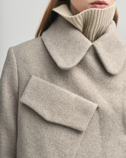 A luxurious double breasted coat in a wool mohair blend with a generous and distinct large collar. Warm heavy and sophisticated wool, with a generous fit and slightly A-line shape. Hidden buttoning and mid-calf length.  <br> <br> - Luxe and warm wool m