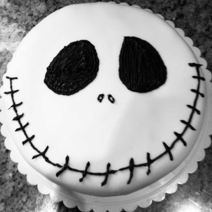 Easy Halloween Treats - DIY Jack Skeleton Cake - make a cake in a box, cover with white fondant and draw Jack's face with black decorating icing! via @Lauren Klein