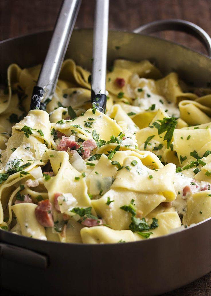 Creamy burrata is tossed with crispy pancetta, chopped herbs, and fresh pappardelle noodles in this quick recipe for pancetta pasta. | justalittlebitofbacon.com
