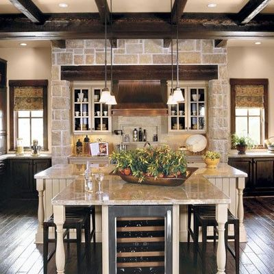 love the recessed niche for cooktop, and the stone facing w/beam