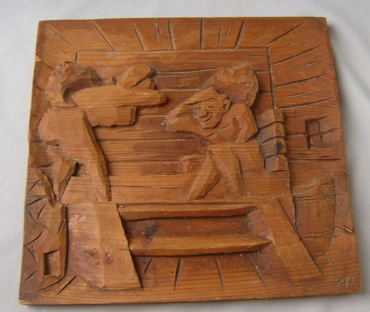 Finnish wood carving high relief man and woman in a sauna