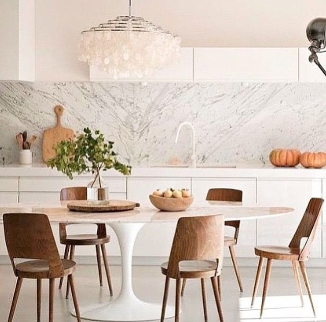 BUTTERFLY EFFECT ON MARBLE SPLASH BACK, THIN INSET CUPBOARD ABOVE BACK, DINING TABLE