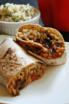 The Ultimate Veggie Burrito. SO easy to make on a busy weeknight! Remove cheese and sour cream for vegan option