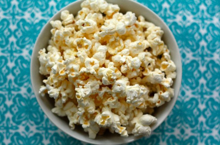 White Cheddar Popcorn...genius.  You use the powdered white cheddar from a box of White Cheddar Macaroni and Cheese!