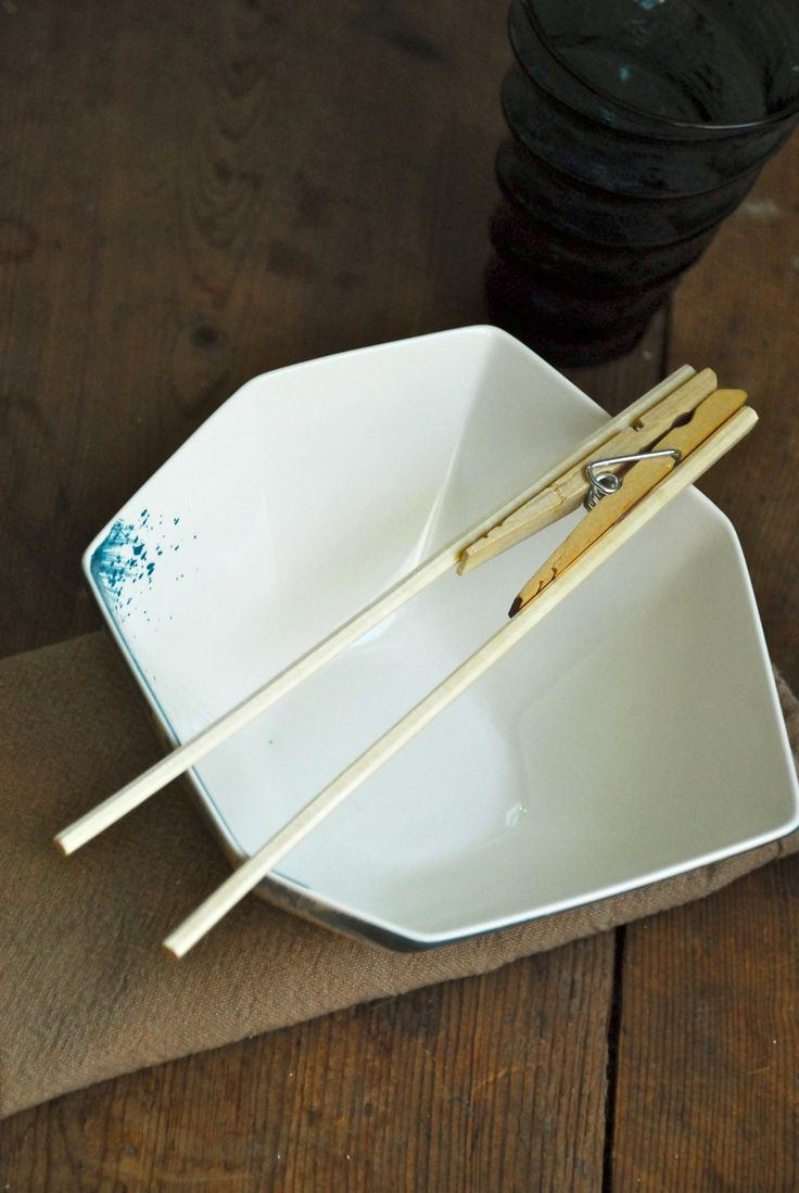 Family Chic Chopstick Trick. Fine motor - use the chopsticks to pick up pompous etc. Discovery Table?