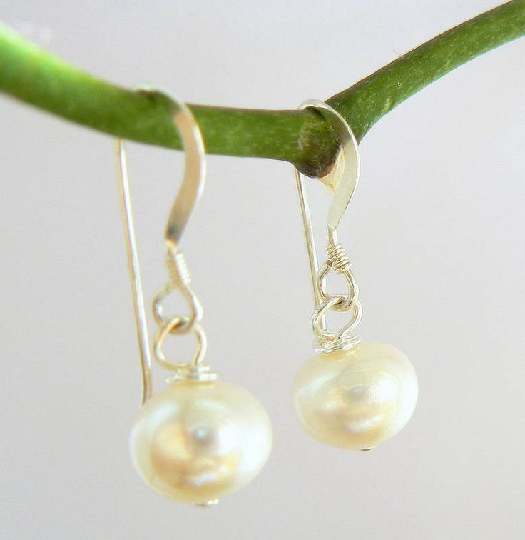ivory freshwater pearl drop earrings by clutch and clasp | notonthehighstreet.com £24.00