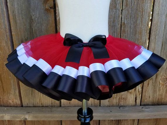 ♡♡♡Please check production time for this item under the shipping tab.♡♡♡ This tutu is made with yards upon yards of super soft ruby red tulle is sewn to layers of black and white satin ribbon! This tutu is made with two layers of tulle for full coverage as well as a full and fluffy