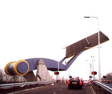 Slauerhoffbrug, Leeuwarden, Netherlands ~In M. C. Escher's hometown of Leeuwarden stands a bridge that resembles something out of War of the Worlds. When a ship traveling down the Harlinger Vaart River needs to cross traffic, a mechanical arm removes a 50-square-foot section of road and hoists it aloft like a giant robot flipping a pancake. VAN DRIEL MECHATRONICA
