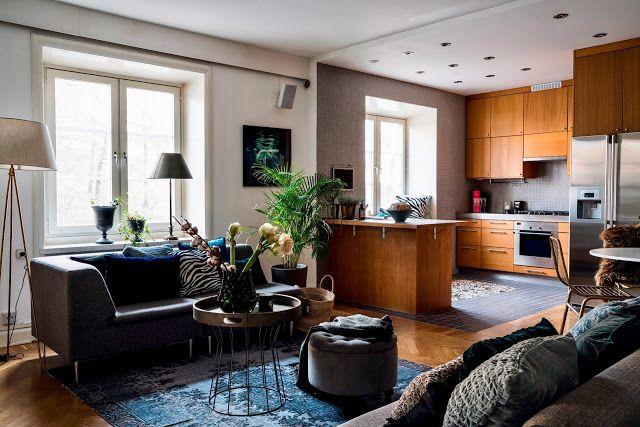 Apartamento com cozinha e salas interligadas