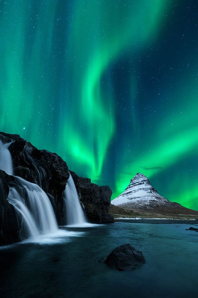 Aurora Borealis over Iceland. Best time to see the Northern Lights in Iceland is in the winter months. Pack warm clothes!
