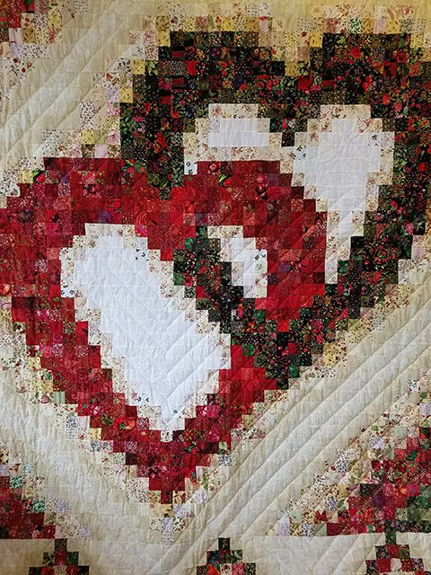 This beautiful hand-quilted Linking Hearts pattern ...