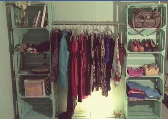 stack crates and stretch clothing hanging bar, and add another bar in front and hang a curtain from it