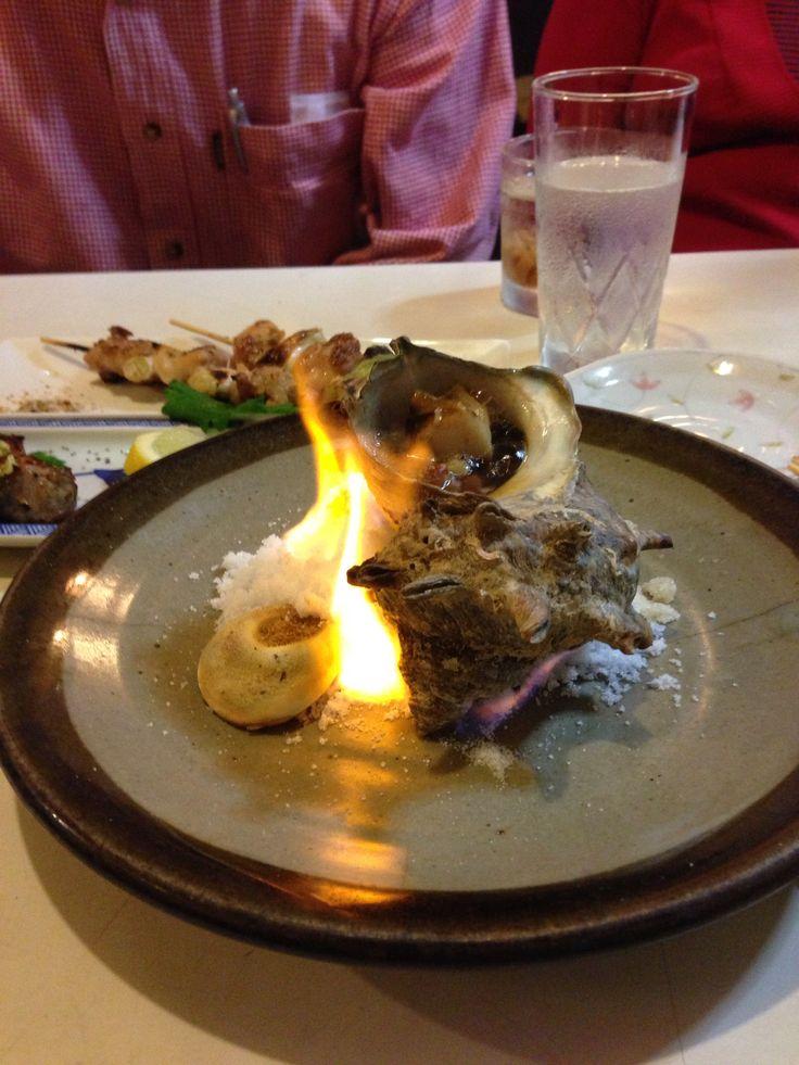 Flaming whelk in shell, Tokyo bar