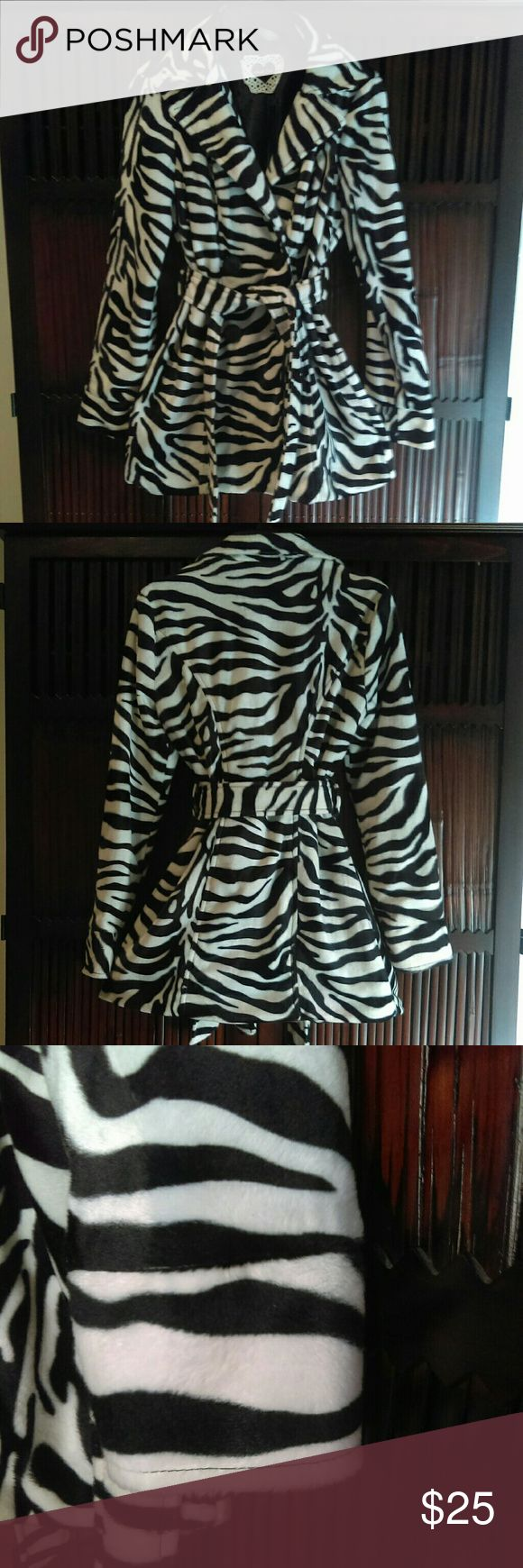 Faux fur zebra print pea coat Never worn perfect condition! Size medium faux fur pea coat with matching belt. Machine washable and dryer safe. Low iron setting okay.  Willing to negotiate price HeartSoul Jackets & Coats