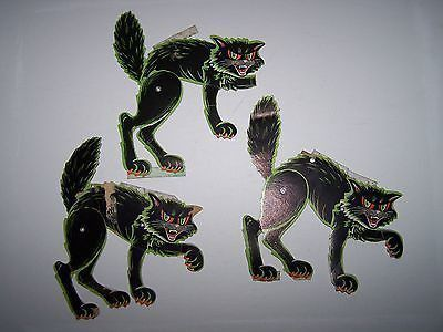 3 Vintage Halloween Cardboard die cut Die Cut Out Beistle Mechanical Cats. The cats measure about 7 and are marked The Beisle Co., Made in USA . The cats are in poor condition with scotch tape on t