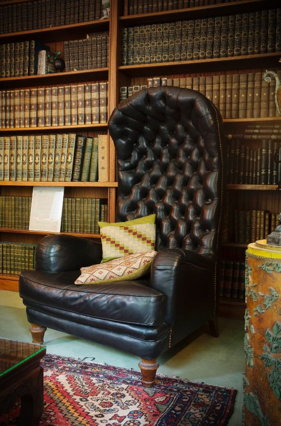 Cosy & inviting look, this buttoned English canopy chair... the home Library of French Radio & Telivision star presenter Philippe Bouvard, Paris