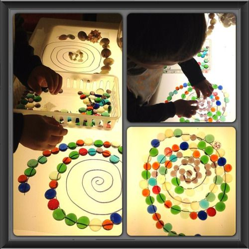 "Light Table Mandalas with various materials. We've used buttons, glass beads, shells, and bottle caps.The children are constantly looking for more small material collections to use in their Mandalas. A mandala ritual can be a very empowering experience for a child. The first step in working with children is making it easy for them to express themselves. ""In simple terms, explain to the children that a mandala is a ""special circle"". You might try saying something like t..."