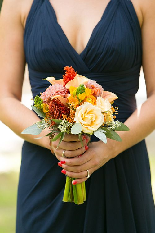 someone posted this for the calla lily and dahlia bouquet - I like the dress style and colour - it's true bridesmaidens can wear pretty dresses :-)