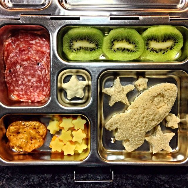 Today's lunch: cucumber + cream cheese rocket sandwich , kiwi, Italian dry salami, pretzel thins (everything), cheese, and yogurt-covered star cookie. #PlanetBox #schoollunch #toddlerlunch #kidslunch #bento #lunchbox #rockthelunchbox #packedlunch #lunchboxideas