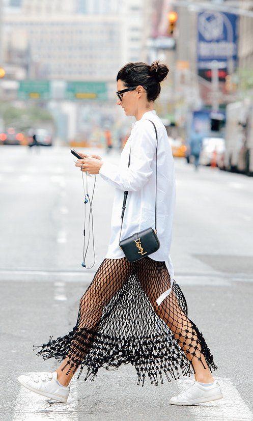 White button down over a black fringe skirt, YSL crossbody and white sneakers Pinterest: KarinaCamerino