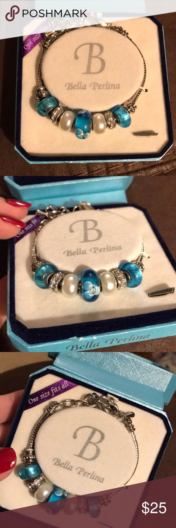 Beautiful blue bracelet Brand new still in the box. Purchased in the Caribbean. Got this as a Christmas present from my ex fiancée parents. Haven't been able to bring myself to wear it. I think it's time it finally gets the home it's always deserved! It truly is a beautiful, well made bracelet! bella perlina Jewelry Bracelets