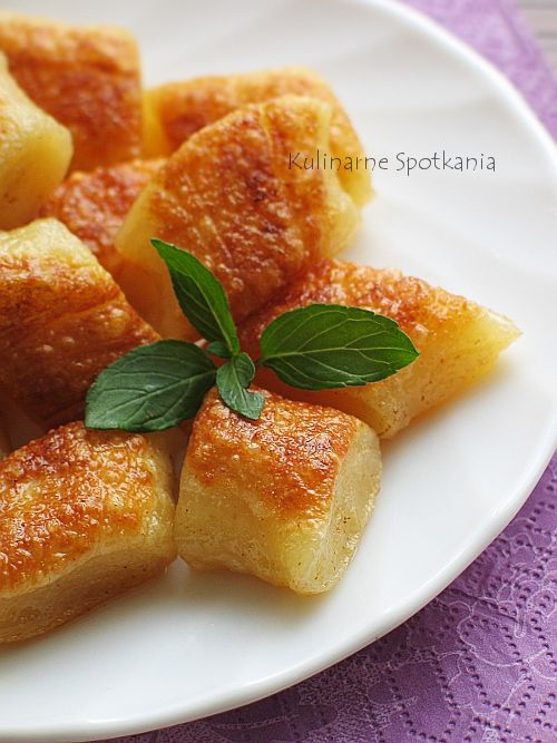 "Kopytka (literally ""little hooves"") are a kind of potato dumpling. They are very similar to gnocchi although they are typically served baked with cheese, fried bacon or onion. The dish is a part of Belarusian, Lithuanian and Polish cuisines."