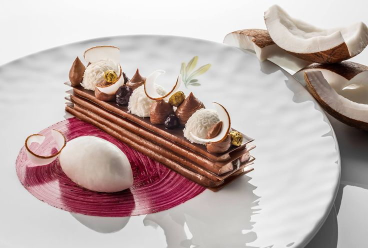 Our pastry chef Eve Moncorger creates desserts that are halfway between art and gastronomy. Here is the Illanka Chocolate with coconut and blackcurrant. Enjoy! — at Château Saint-Martin & Spa. #RelaisChateaux #Dessert #Chocolat